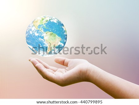 Female hands holding floating earth on pastel blur heaven clouds sky sunset background. Soft focus blue sky white sunlight day time. Open view out windows : Elements of this image furnished by NASA - stock photo