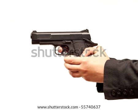 Female Hands Holding Gun Ready to Fire - stock photo