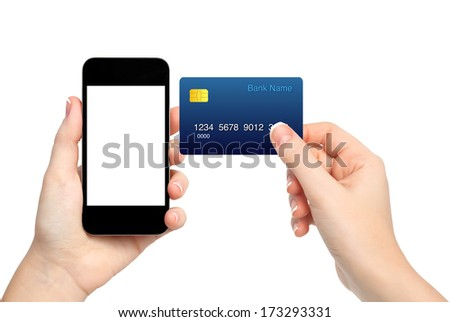 female hands holding phone and credit card on isolated background - stock photo