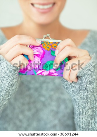 Female hands holding smiling a money pocket wallet - stock photo