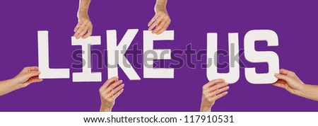 Female hands holding the text word for LIKE US in white capital letters isolated on a purple studio background - stock photo