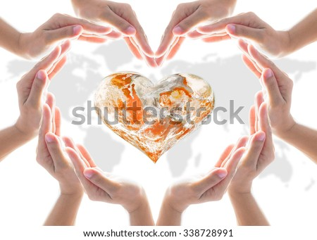 Female hands in heart shaped protecting orange color globe on white map background: Orange the World: End Violence against Women and Girls concept campaign: Elements of this image furnished by NASA  - stock photo