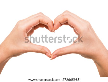 Female hands in the form of heart isolated on white background. - stock photo