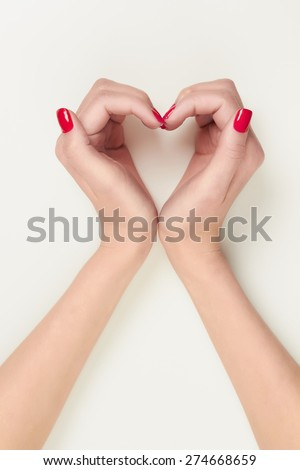 Female hands in the form of heart symbol isolated on white background.beauty woman hands with manicure - stock photo