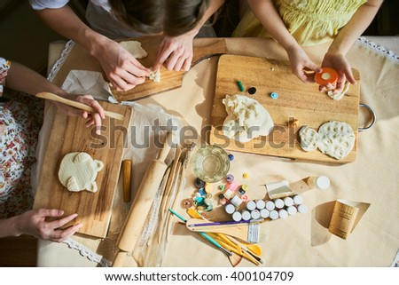Female hands making a hand made product made from dough - stock photo