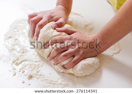 Female Hands Making Dough for baking .Homemade Preparing Food. - stock photo