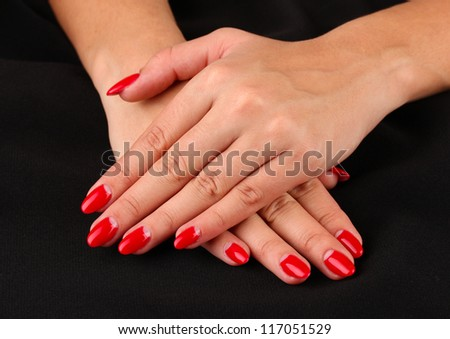 Female hands on color background