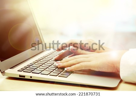 Female hands on laptop, close-up - stock photo