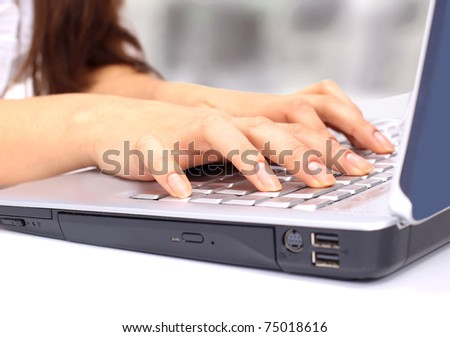 Female hands on the keyboard of the computer