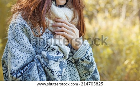 female hands over the sweater (soft focus) - stock photo