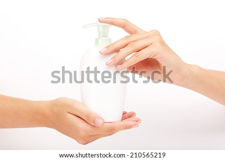 Female hands presenting liquid soap - stock photo