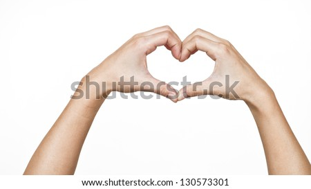 Female hands shaping a heart symbol on white background - stock photo