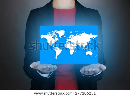 Female hands showing earth globe on dark background