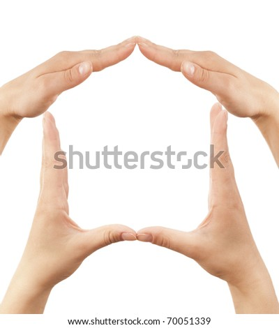 Female hands showing home sign