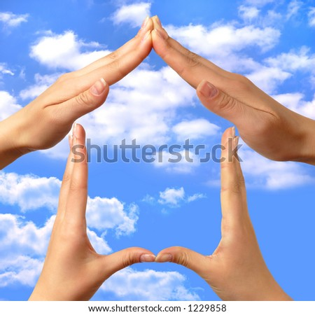 Female hands showing home sign family house concept sky background - stock photo