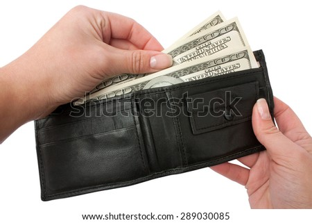female hands take out money from a black purse on a white backround isolated