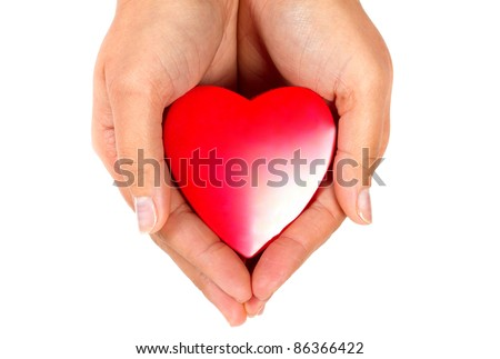 Female hands taking care of red heart - stock photo