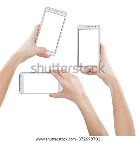Female hands taking photo with smart phone of blank white touch screen, front view, isolated on white. - stock photo