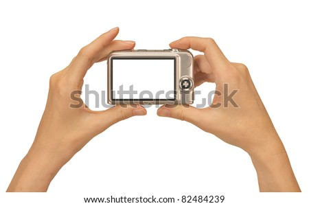 female hands taking picture with a compact digital camera - stock photo