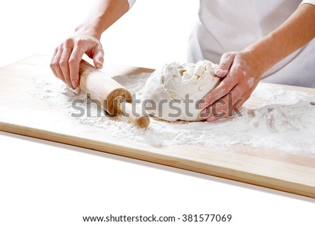 female hands taking rolling pin for making dough on board isolated on white background   - stock photo
