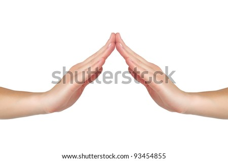 female hands touch each other in form of a house or a roof isolated on white background - stock photo