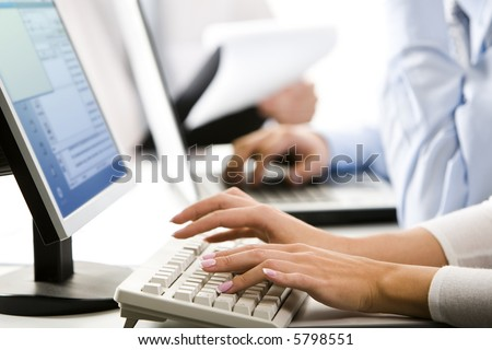 Female hands typing a letter on the keyboard - stock photo