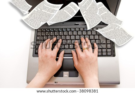 female hands typing on a laptop computer with book pages flying around - stock photo