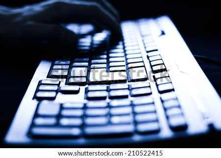 Female hands typing on computer keyboard. studio shot - stock photo