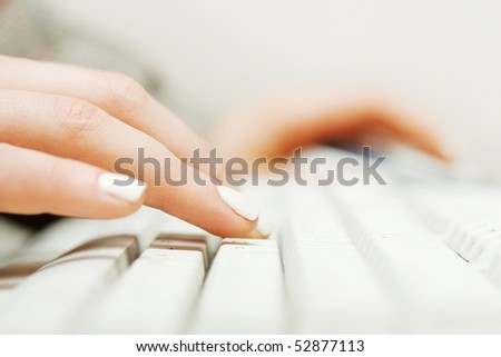 Female hands typing on the computer keyboard. - stock photo