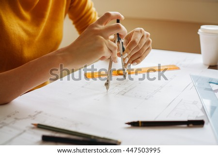 Female hands using compass for a technical drawing    - stock photo