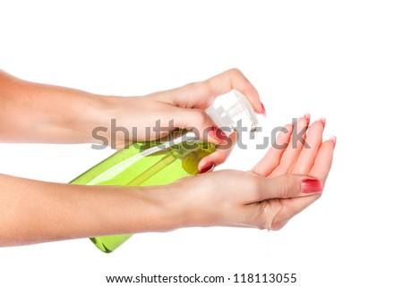 Female hands using hand sanitizer gel pump dispenser. Isolated on white background - stock photo
