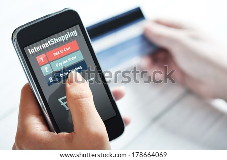 Female hands using smart phone for internet shopping - stock photo