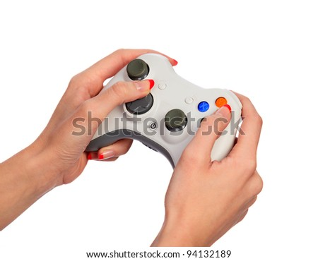 Female hands with a gamepad. Isolated on white background