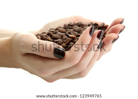 female hands with coffee beans, isolated on white - stock photo