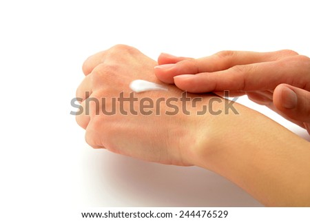 Female hands with cream, isolated on white background - stock photo
