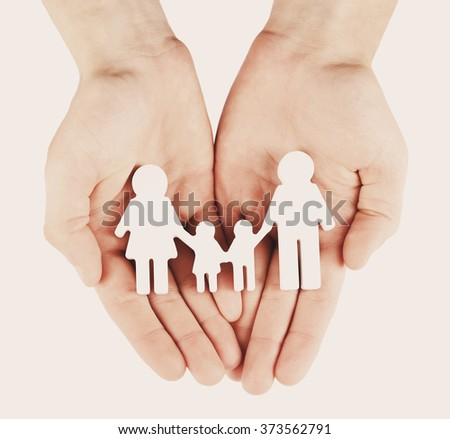 Female hands with family model on light background, close-up - stock photo