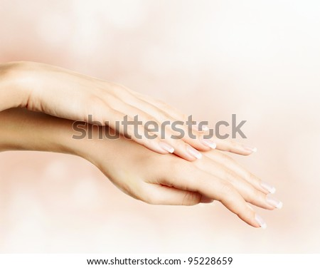 Female hands with french manicure - stock photo