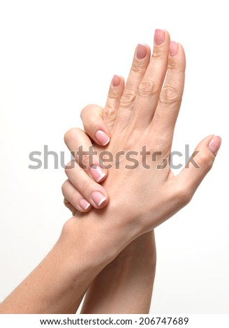 female hands with french manicure isolated  - stock photo
