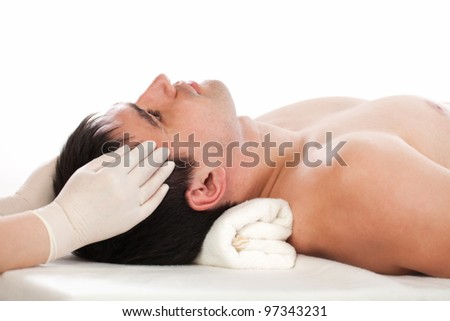 female hands with gloves at the temples men - stock photo