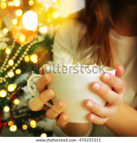 Female hands with hot drink