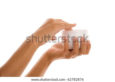 Female hands with jar of body lotion