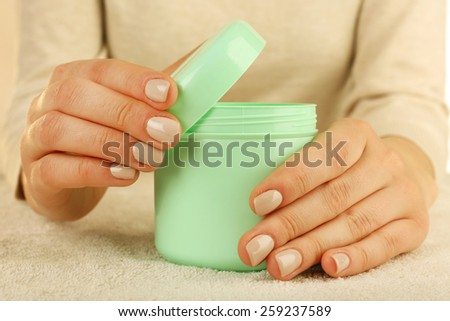 Female hands with jar of cream close up - stock photo