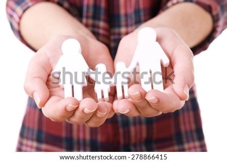 Female hands with model of family isolated on white