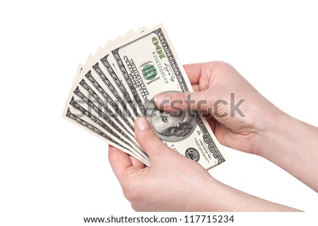 female hands with money isolated on a white background. Dollars