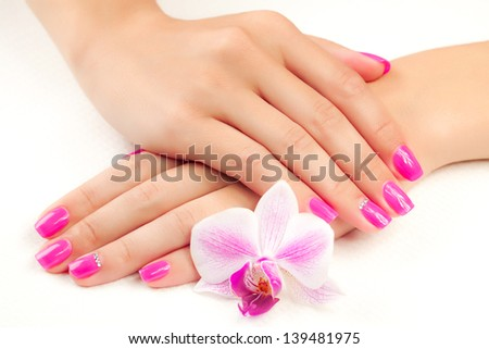 female hands with orchid flower - stock photo
