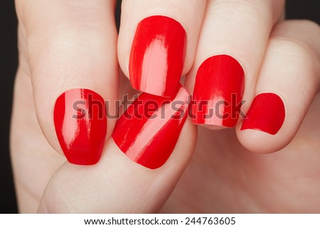Female hands with red nail polish close up - stock photo