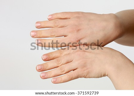 female hands, woman rubs his hands with cream, french manicure - stock photo
