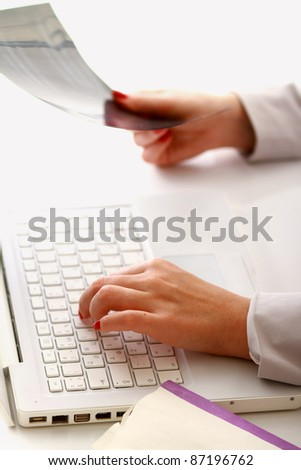 Female hands working on a laptop, closeup - stock photo