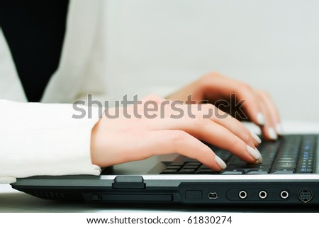 Female hands working on laptop.
