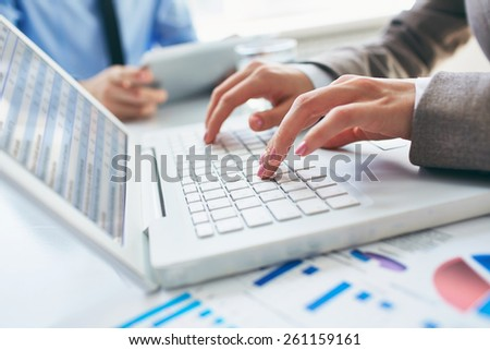 Female hands working with laptop - stock photo